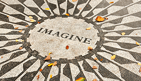 Abstract mosaic with the word Imagine in the center
