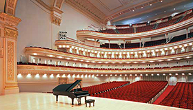 Interior photo of Carnegie Hall stage and seating