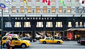 Street view of Bloomingdales with taxis in front of entrance